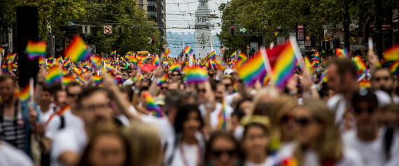 SAN FRANCISCO, CA- JUNE 28: San Francisco's Ferry Builiding is seen behind marchers in the San Francisco Gay Pride Parade, June 28, 2015 in San Francisco, California. The 2015 pride parade comes two days after the U.S. Supreme Court's landmark decision to legalize same-sex marriage in all 50 states. (Photo by Max Whittaker/Getty Images)
