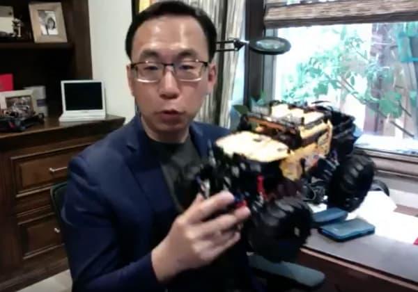 Dr Allen Yang Showing a Robot