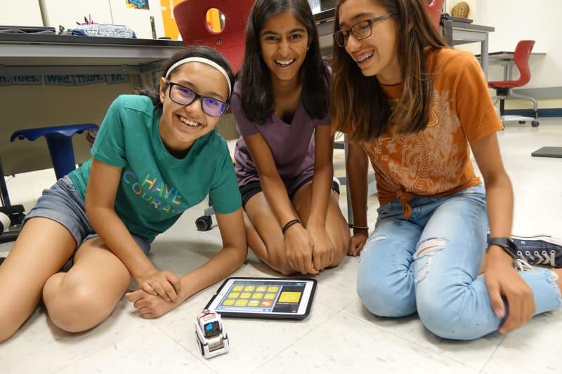 Girls building a circuit board