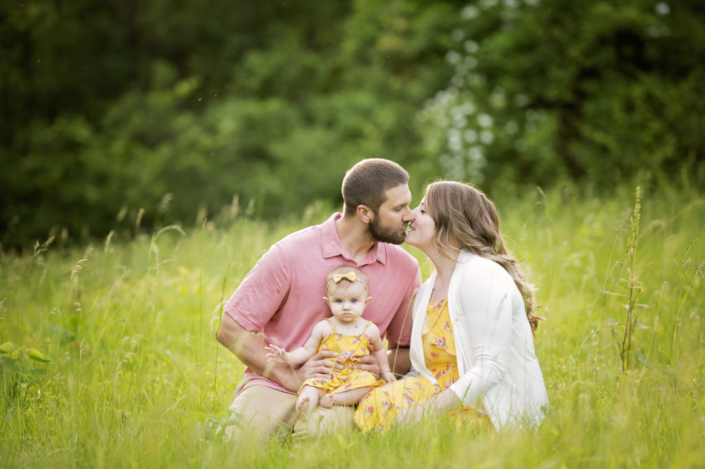 candid outdoor family photo in grass