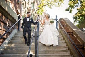 groom holding brides hand