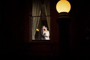 couple in window wedding photography