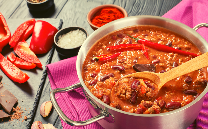 chili pot, wooden spoon, and ingredients