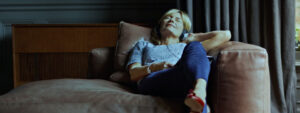 Gandy HVAC has helped make this women's home comfortable so she's lying down on a leather couch
