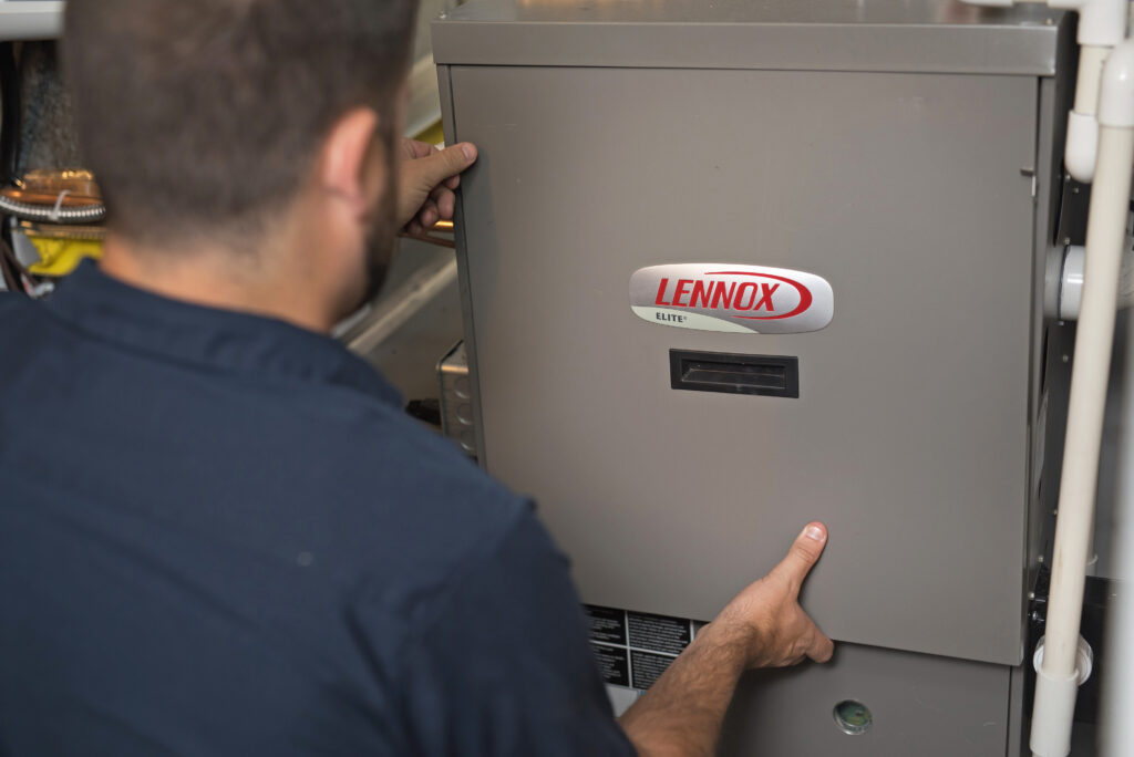 Gandy Heating Technician working on Lennox boiler