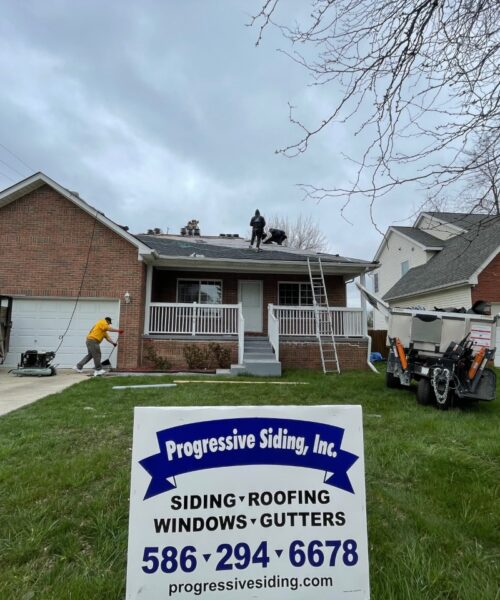 Progressive Siding contractors completing re-roofing residential home