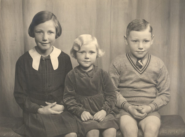 About 1938, with my two sisters: Helen (11), Betty (6) and me (9)