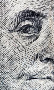 Ben Franklin's eye on the $100 dollar bill