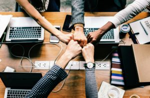 why routine is good for you - hands together bumping fists as a sign of team work!