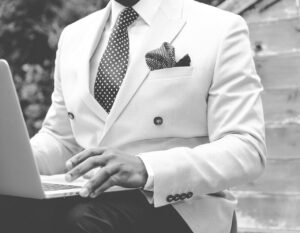 be a boss of your life, man in nice suit with laptop