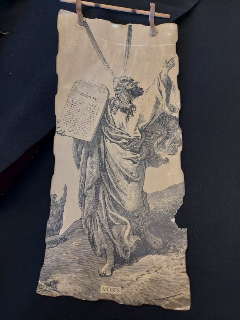 This is Moses holding the Stone tablet with the 10 commandments, Inscribed by the Finger of God, on Mount Sinai.