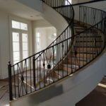 Large Curved Staircase Railing and Matching Balcony Rails