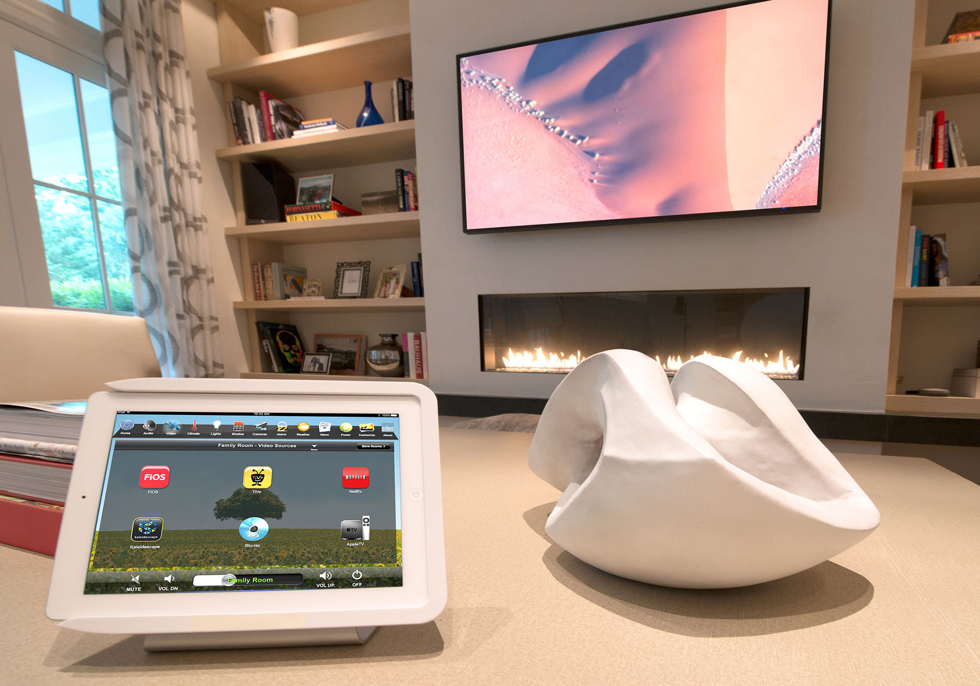 living room, iPad, tabletop dock, video screen, speakers, bookshelf speakers