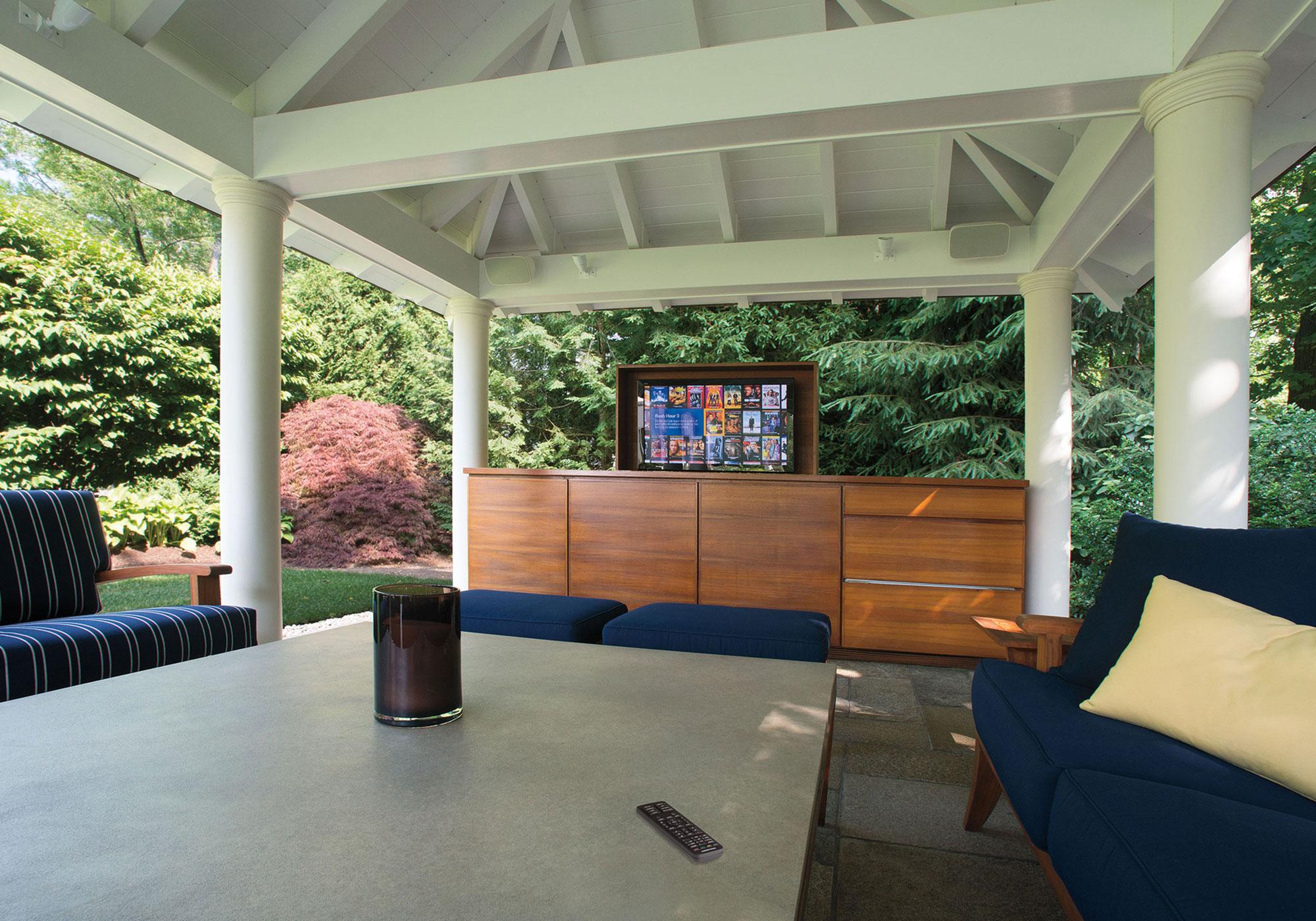 patio, tv, waterproof tv, lift, cabinetry, millwork, handheld remote
