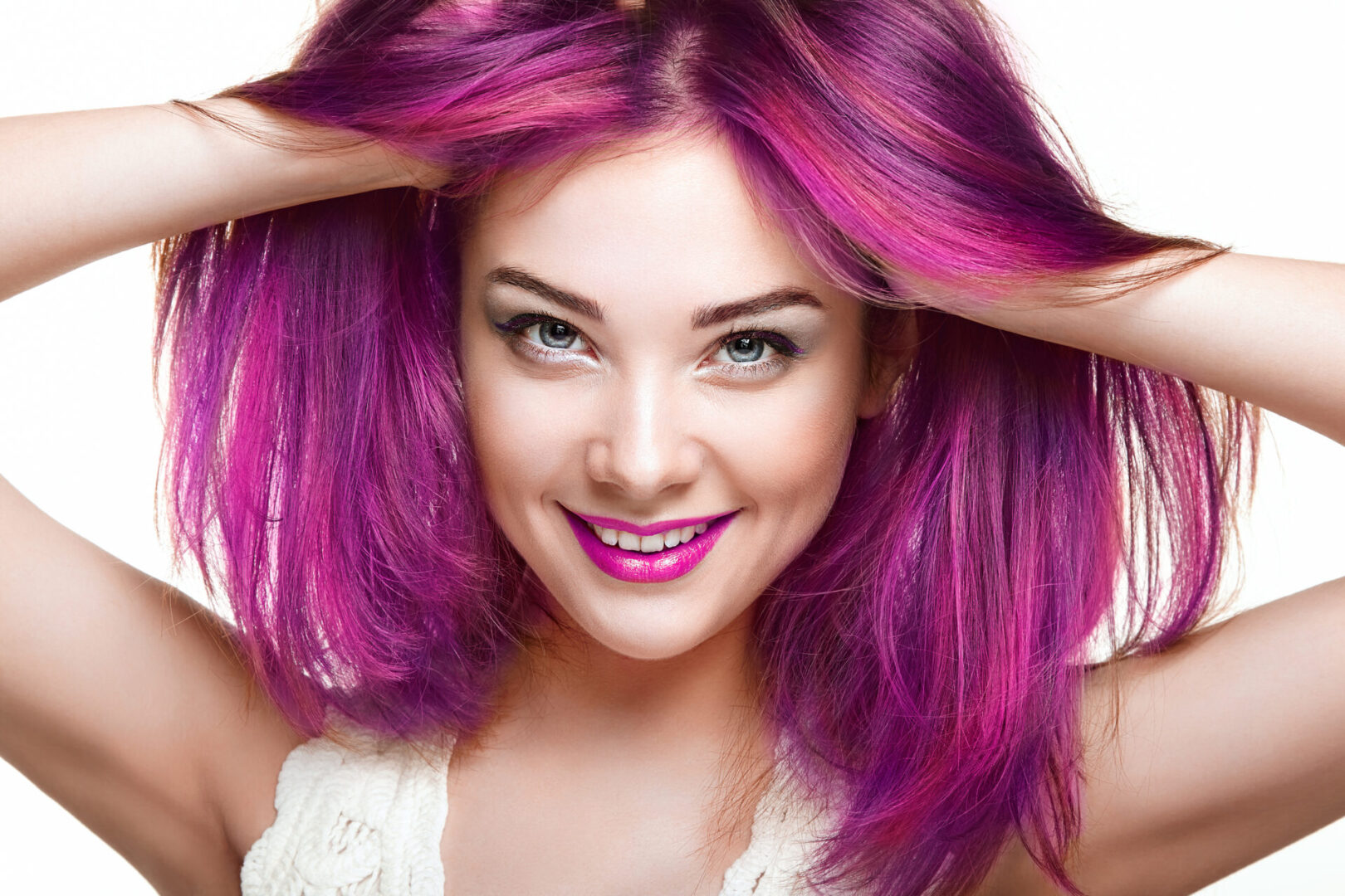 Beauty Fashion Model Girl with Colorful Dyed Hair. Girl with perfect Makeup and Hairstyle. Model with perfect Healthy Dyed Hair. Pink Hair. Woman Smiling
