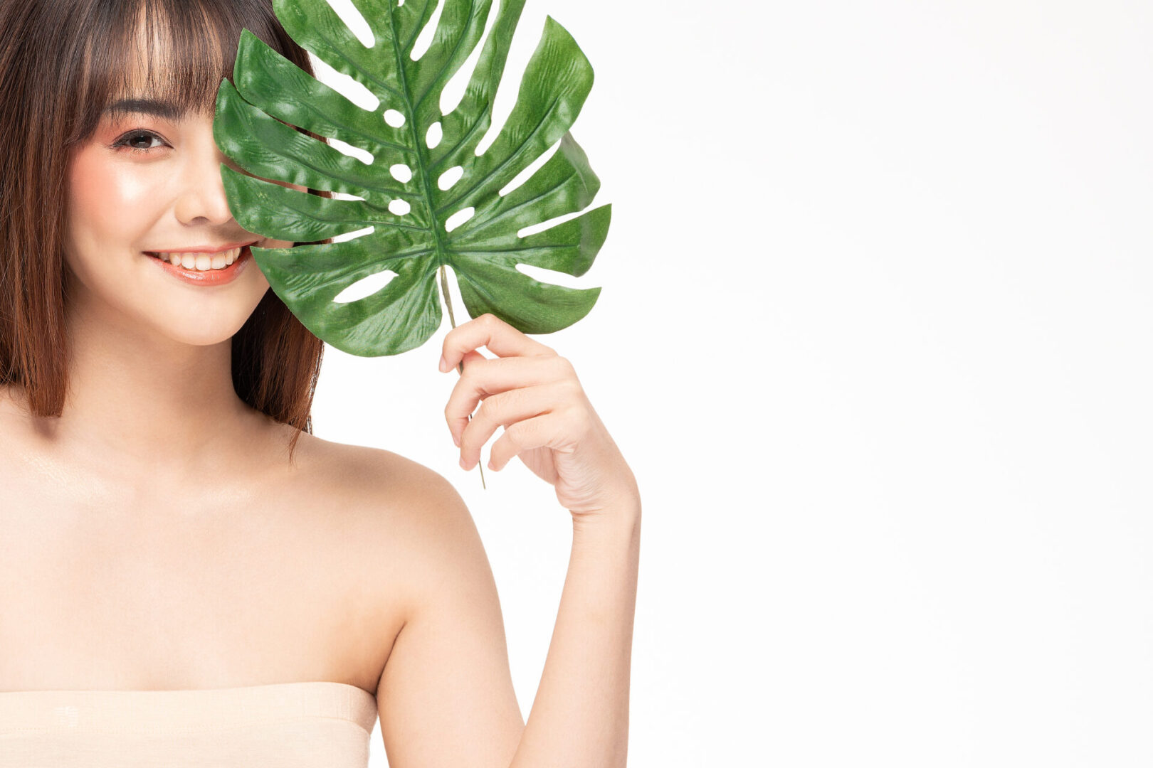 Beauty asian women  touching soft cheek portrait face with natural skin and skin care healthy hair and skin close up face beauty portrait.Beauty Concept on white background.