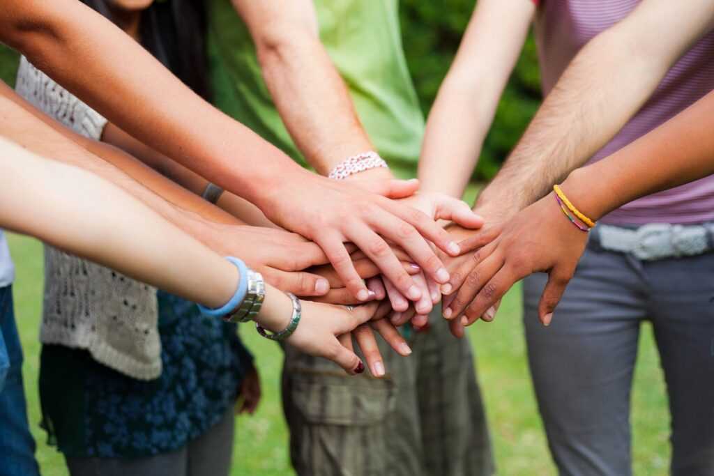 8 hands all touching as sign of group support