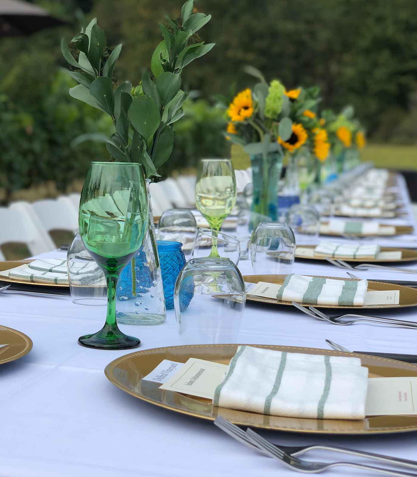 Photo of Dinner Table with a White Table Cloth and all the Cutleries Neatly Arranged to host an Event at Pomeroy Cellars