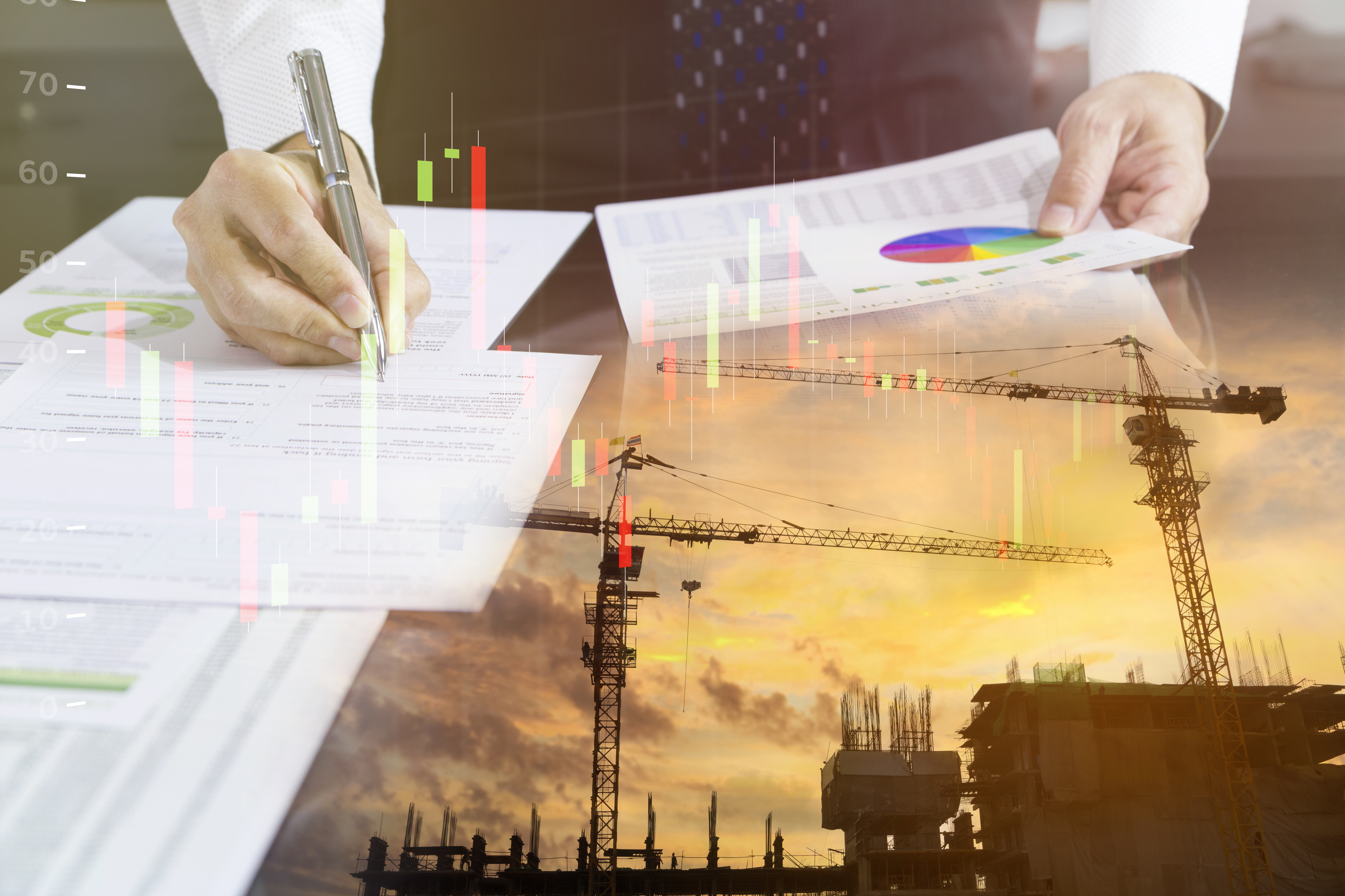 Businessman signing on a building construction contract with construction site reflection on foreground.