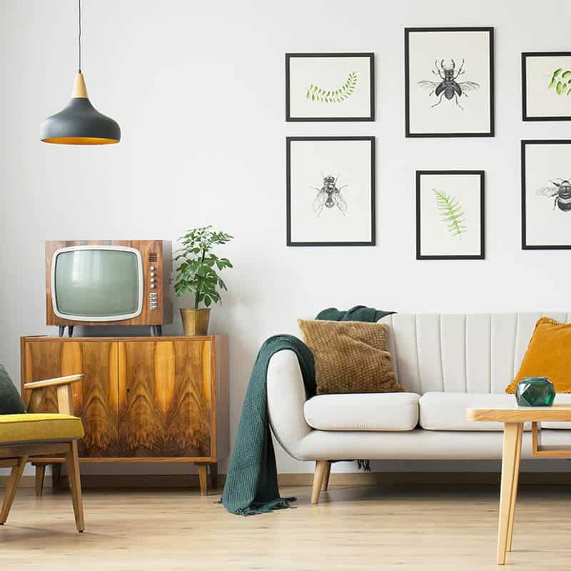 Living Room with sofa, tv, cabinets, and decor