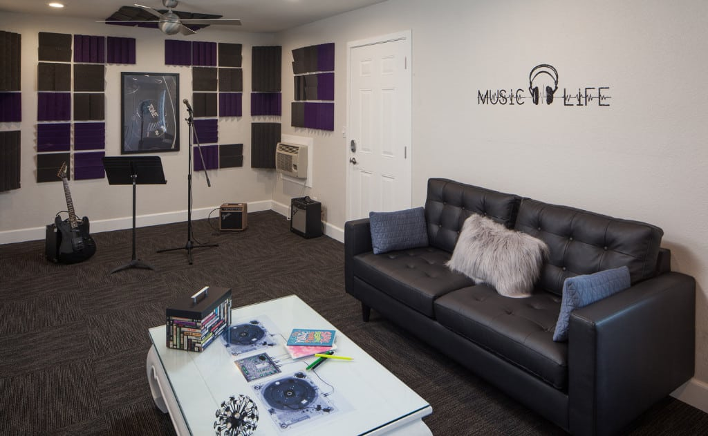 Black sofa and music equipment in music room