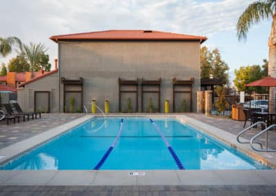 Lap Pool at Corona Pointe Resort with outdoor seating