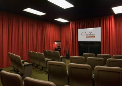 Movie Room with red curtains, chairs, popcorn maker, and projector screen