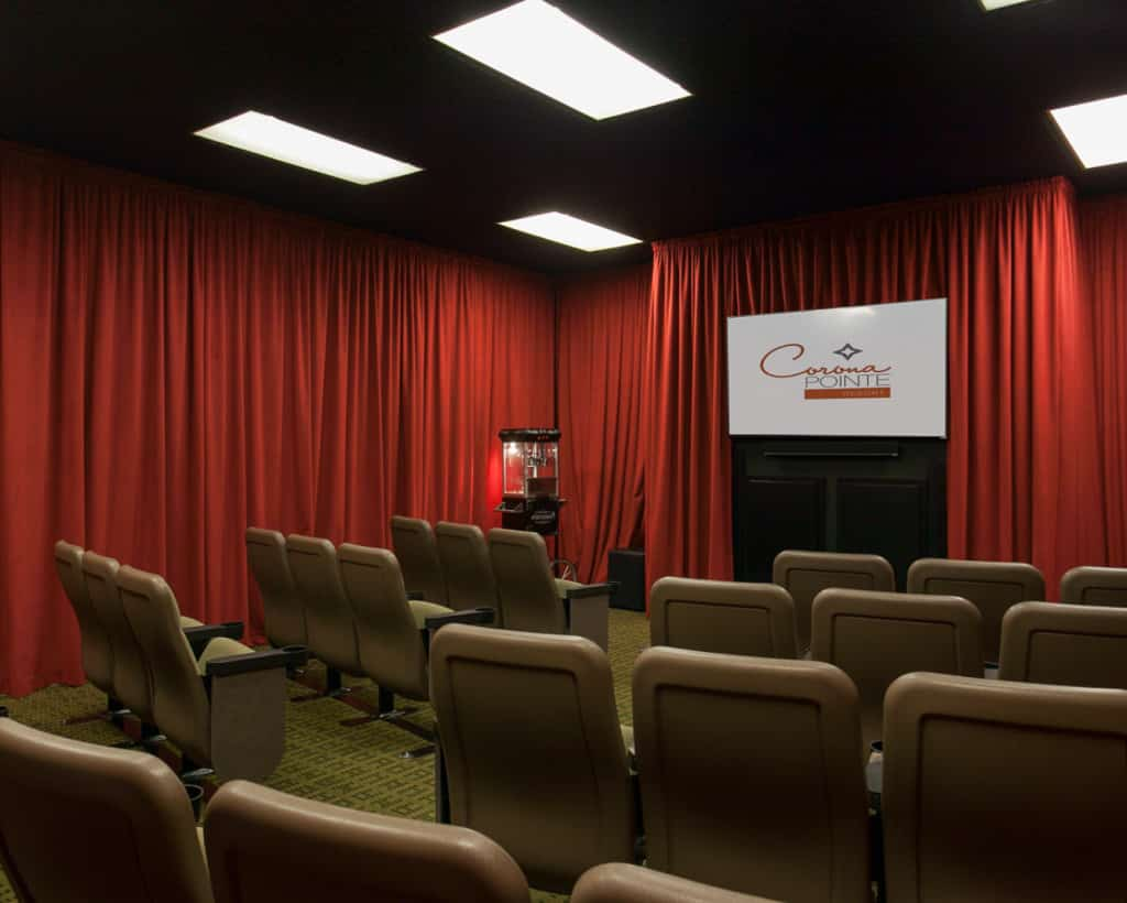 Movie Room with chairs, popcorn machine, red curtains, and projector screen