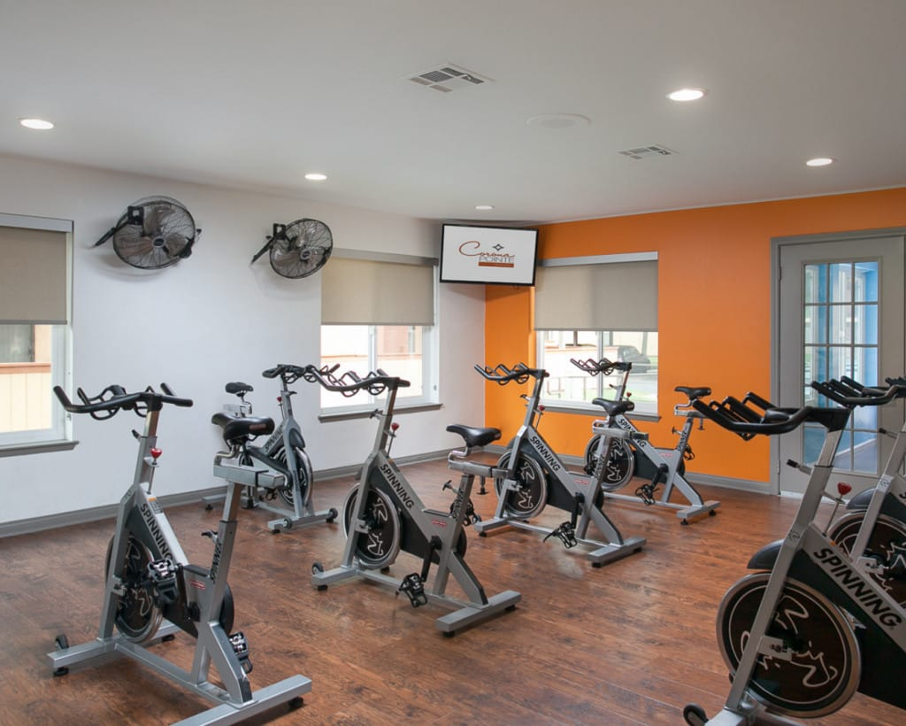 Cycling studio with fans and television