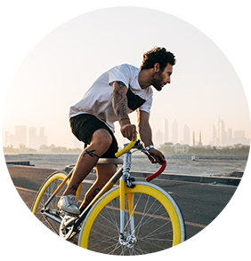 Man Riding Bike with City in the background