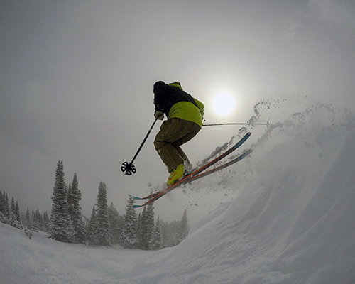 Surreal Brewing Tribe Member Larry catching some air while skiing