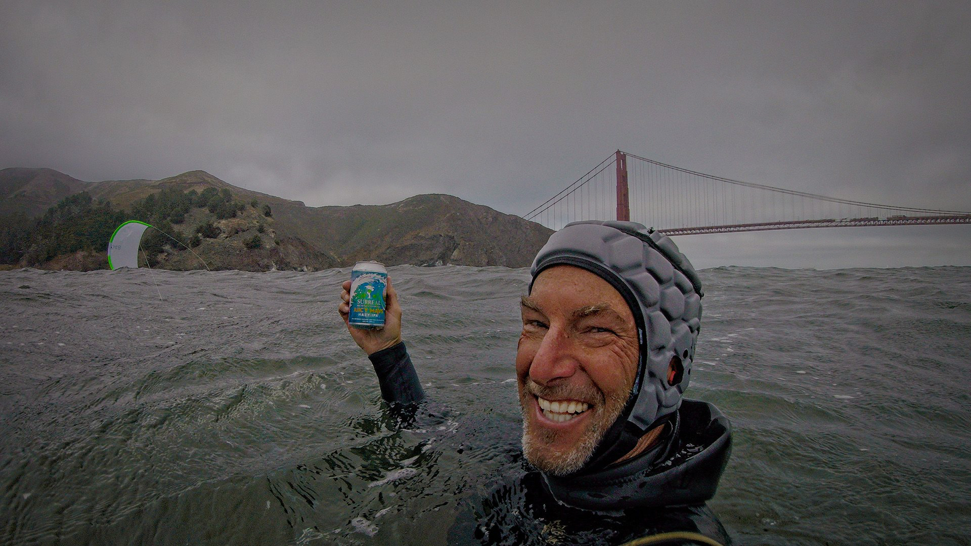 Guy enjoying a non-alcoholic beer with the golden gate bridge in background