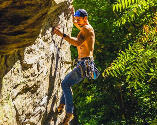 Surreal Brewing Tribe Member Adam rock climbing