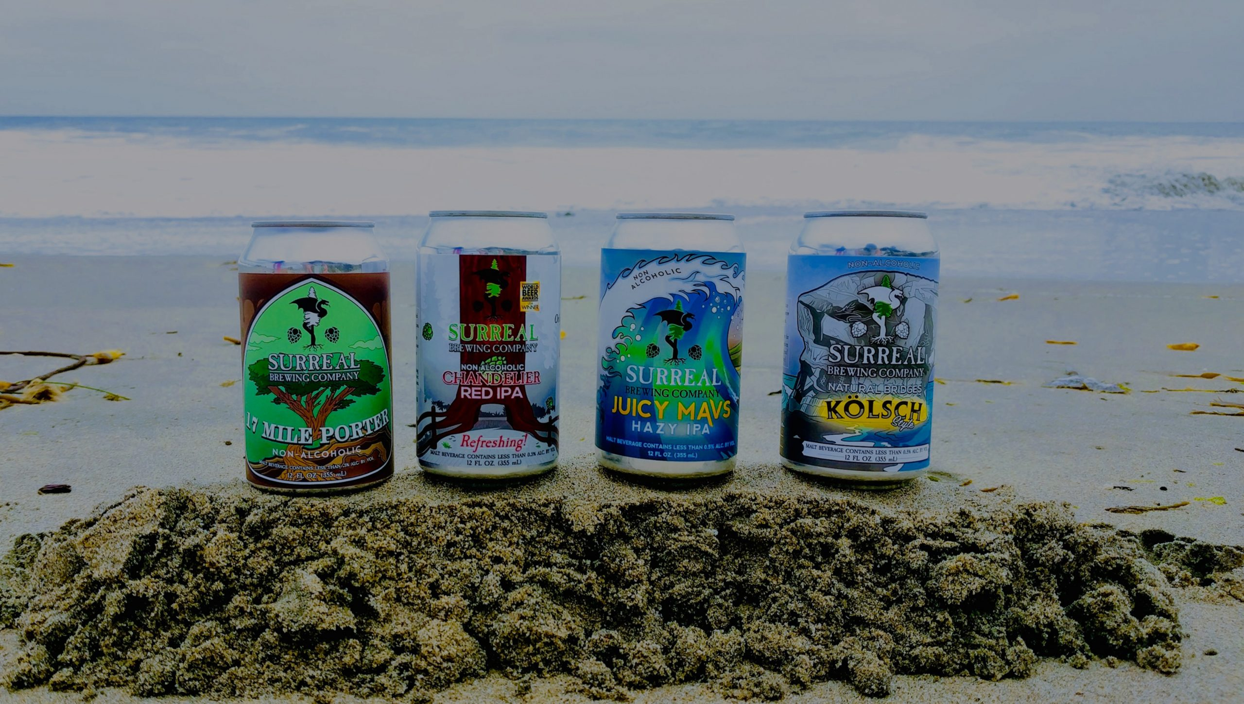 Surreal Brewing Craft non-alcoholic beer on the beach