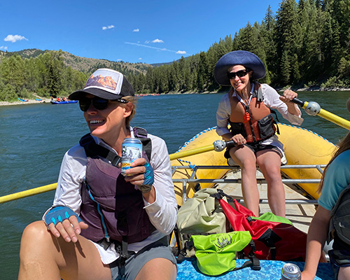 Surreal Brewing Tribe Member Emilee Rafting with a Cold non-alcoholic beer in hand