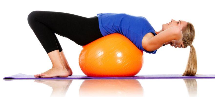 woman doing pilates on ball
