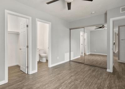 empty bedroom with wardrobe, shoe closet, and bathroom
