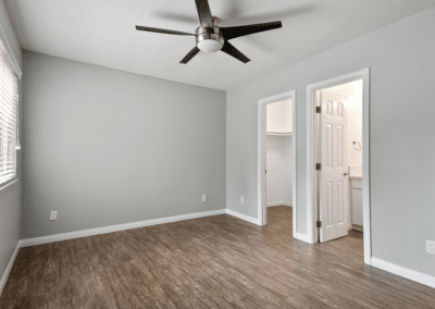 empty bedroom with a ceiling fan and wooden floors