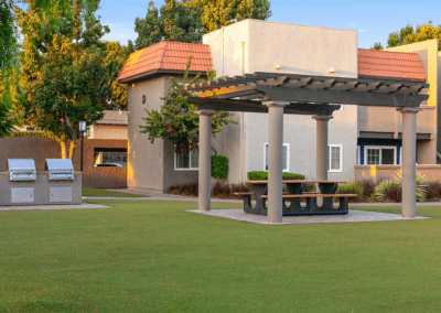 bbq grills and picnic area with table and benches