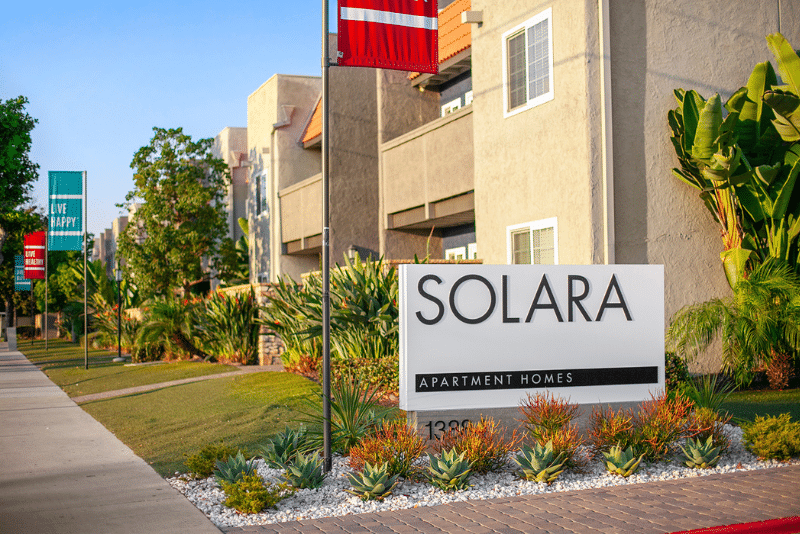 Solara Apartment Homes Sign with landscaping