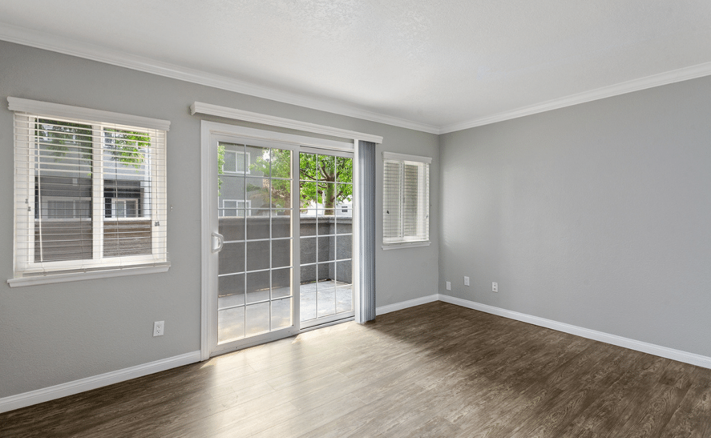 empty living room with windows and patio space