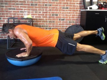 Client Robert Knotek shredded arms legs pushups on Bosu ball after picture