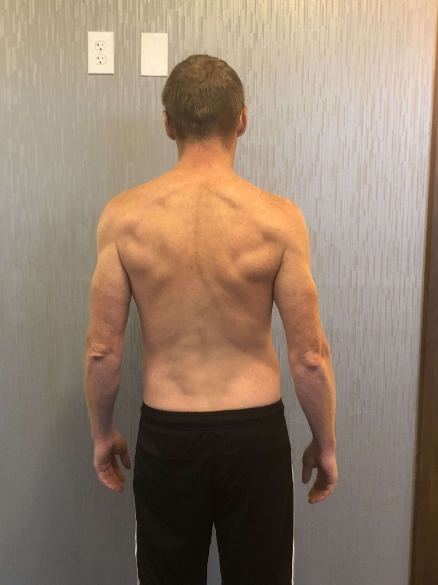 Client Bryan Reeves after picture weight loss results with shredded back muscles
