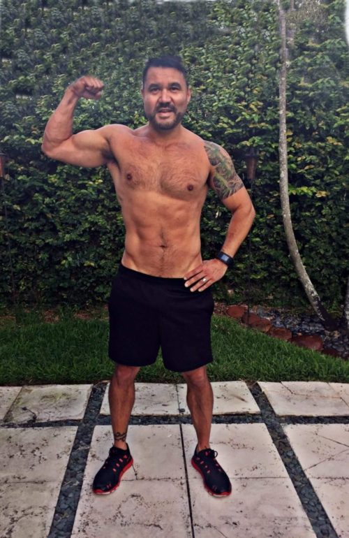 Client Don Donahue flexing his muscles for after picture shredded cut six pack abs