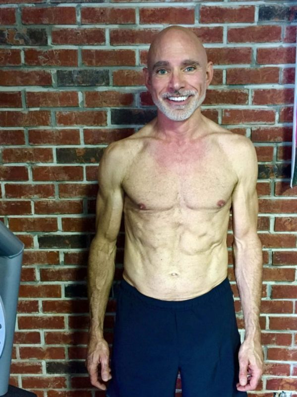 Client Wayne LeBlanc six pack abs smiling frontal after picture