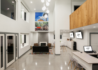 Office Lounge with high ceilings and furniture