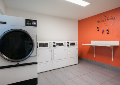 Laundry room with orange wall and folding table