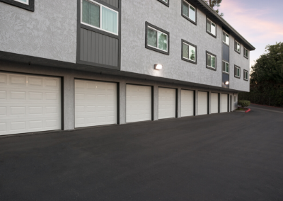 Garage units with covered garages at sunset