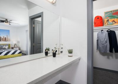 Bathroom with view into closet