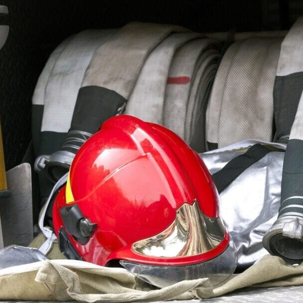 red fire helmet and hose
